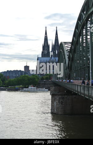 looking towards Cologne Cathedral across the River Rhine and one side of the Hohenzollern Bridge, Cologne, Germany - Stock Photo