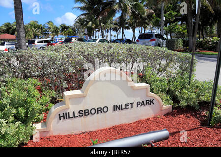 POMPANO BEACH, FLORIDA - FEBRUARY 12, 2014: Entry sign to the left of opening to Hillsboro Inlet Park and parking - Stock Photo