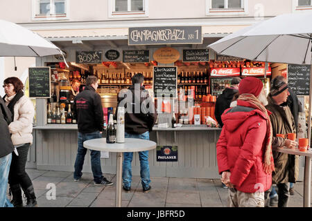 Outdoor champagne bar located in a Christmas market in Salzburg, Austria. - Stock Photo
