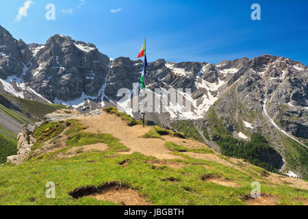 panoramic point with flags from San Nicolo' pass with Costabella ridge on background, Trentino, Italy - Stock Photo