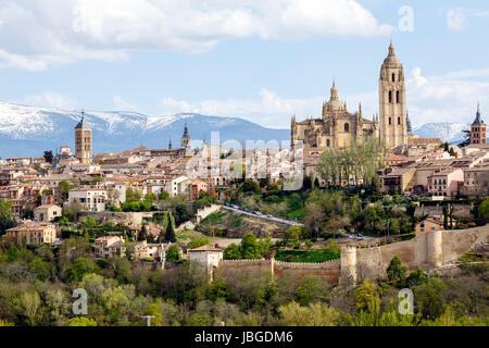 Cathedral of Segovia , with the Sierra de Guadarrama as background - Stock Photo