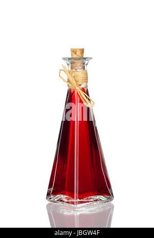 Flasche Chiliöl mit Spiegelung vor weißem Hintergrund - Stock Photo