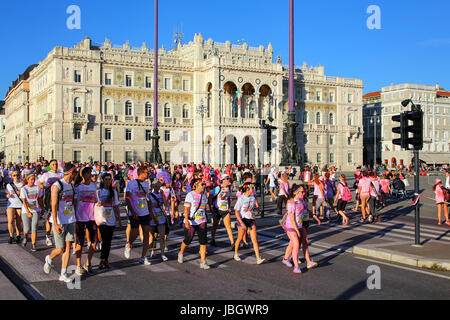 People taking part in The Color Run in Trieste, Italy. Trieste is the capital of the autonomous region Friuli-Venezia - Stock Photo