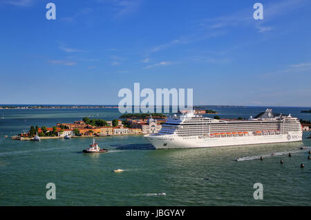 Cruise ship moving through San Marco canal in Venice, Italy. Venice is situated across a group of 117 small islands - Stock Photo