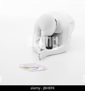 man dressed in white with black tie prays to money, standing on his knees, on white background - Stock Photo