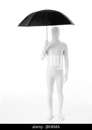 faceless man dressed in white standing with an umbrella over his head - Stock Photo