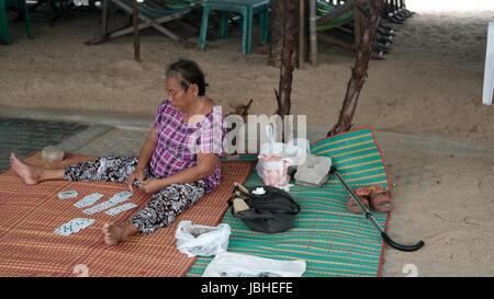 Old Lady Card Reader Fortune Teller selling on Beach Road Pattaya Chonburi Thailand Gulf of Thailand - Stock Photo
