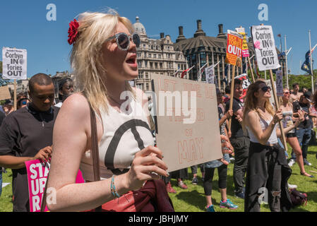 June 10, 2017 - London, UK - London, UK. 10th June 2017. A woman holds a poster 'Let June Be the End of May' at - Stock Photo