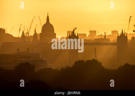 London, UK. 11th June, 2017. UK Weather: Dramatic sunset light over the city landscape with St. Paul's Cathedral - Stock Photo