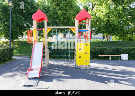 Modern Playground Equipment. Modern Colorful kids playground on yard in the park. image for background of playground, - Stock Photo
