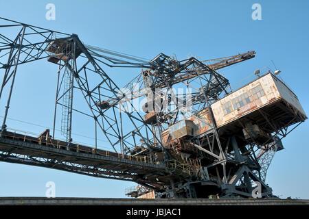 gigantic excavator in the abandoned brown coal opencast mine ferropolis - Stock Photo