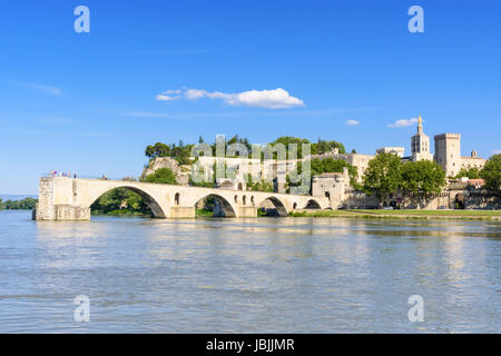 Medieval city views and the four remaining arches of Avignon bridge, the Pont Saint-Bénézet from the Rhone River, - Stock Photo