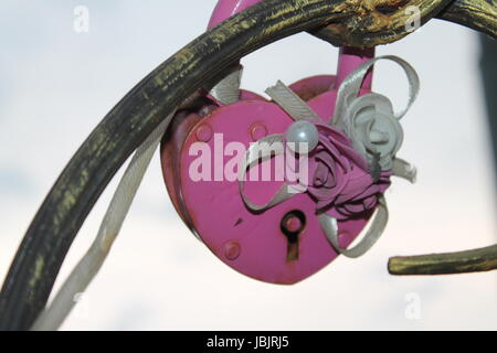 the lock in the form of heart hanging on a metal artificial tree lovers.