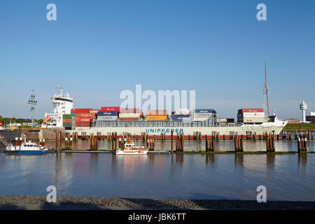 The container vessel Ida Rambow at the departure of the lockage Brunsbuettel on May 17, 2014. - Stock Photo