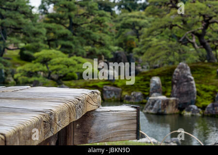 Old, weathered timber platform, overlooking Ninomaru garden pond. - Stock Photo