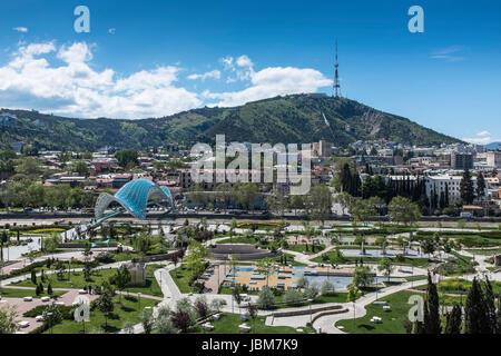 Tbilisi, Georgia, Eastern Europe - Rike Park, Peace Bridge and Tbilisi TV Tower. - Stock Photo