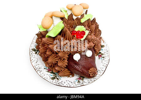Cake in the form of a hedgehog, adorned with green leaves with cream, mushrooms from the biscuit and meringue, berries, - Stock Photo
