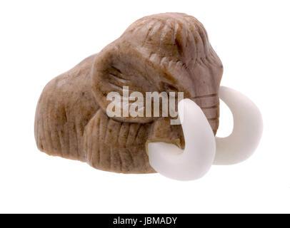 Mammoth Stone Figurine on white Background - Stock Photo