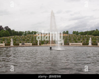 POTSDAM, GERMANY - MAY 10, 2014: Tourists visiting the baroque Schloss Sanssouci former summer palace of Frederick - Stock Photo