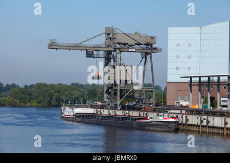 Unloading coal from the freighter Niedersachsen 22 at the power plant Tiefstack (Vattenfall) on Hamburg on May 17, - Stock Photo