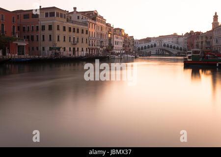 Golden Sunrise at Rialto at Canal Grande, Venezia - Stock Photo