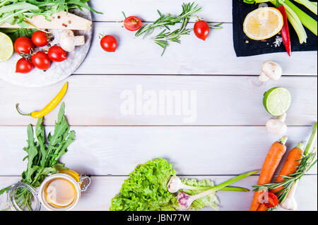 Healthy food background. Different vegetables on white wooden table. Picnic concept., space for text. Selective - Stock Photo