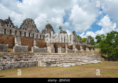 Mayan architecture: ruined wall in Uxmal, an ancient Maya city and archaeological site near Merida, Yucatan, Mexico, - Stock Photo