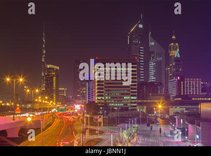 DUBAI, UAE - MARCH 31, 2017: The nightly skyline of Downtown with the Burj Khalifa and Emirates Towers. - Stock Photo