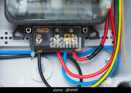 Close up picture of part of an electric switchboard in domestic use - Stock Photo