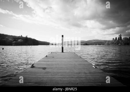 Black & White image of a jetty on Lake Windermere - Stock Photo