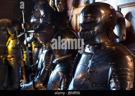 Display of armoury / suits of armour and helmets in the great Hall of Warwick castle in Warwickshire, UK. (88) - Stock Photo