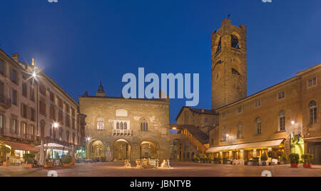 Bergamo - The Piazza Vecchia square at dusk. - Stock Photo