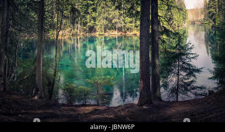 Natural spring in southern Finland. Water is so clear that it´s turquoise color. Water can be drink directly from - Stock Photo