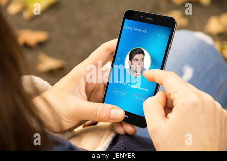 social media connection concept: woman holding a 3d generated smartphone with request on the screen. Graphics on - Stock Photo