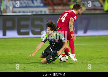 BELGRADE, SERBIA - JUNE 11, 2017: Joe Allen (L) of Wales fights for the ball with Nemanja Gudelj (R) of Serbia during - Stock Photo