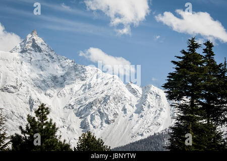 Titanic snow covered mountain peak of sacred Kinner Kailash at an elevation 6,050 m. Beautiful winter landscape - Stock Photo