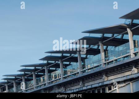 Detail of modern Blackfriars rail bridge over River Thames against blue sky - Stock Photo