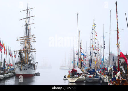 BERGEN, NORWAY - AUGUST 11, 2008: Sailing ships participating in The Tall Ships' Races anchoring in the harbour - Stock Photo
