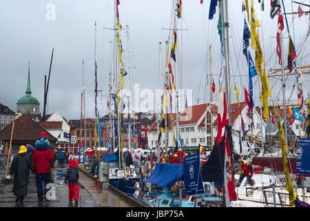 BERGEN, NORWAY - AUGUST 11, 2008: Unidentified people and sailing ships in the harbour on August 11, 2008 in Bergen, - Stock Photo