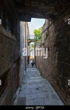 Narrow alleyway with view onto sea, Korcula - Stock Photo