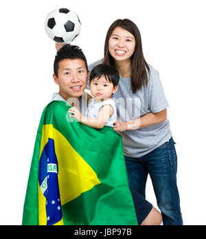 Family of Brazilian soccer fans - Stock Photo