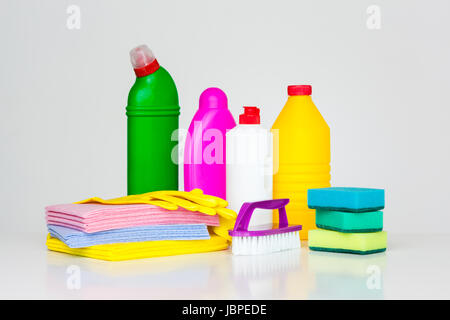 Range of household cleaners. Detergents, chemical bottles, cleaning sponges and gloves. on a white background - Stock Photo