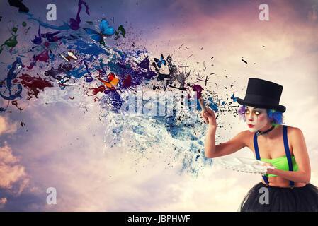 Painter clown paints the sky - Stock Photo