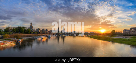 Dresden city skyline panorama at Elbe River and Augustus Bridge when sunset, Dresden, Germany - Stock Photo