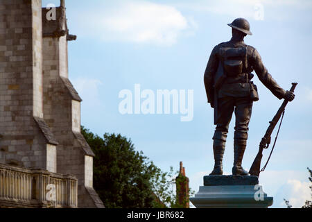 Bronze statue of a rifleman - a memorial to the King's Royal Rifle Corps against the background of Winchester Cathedral, - Stock Photo
