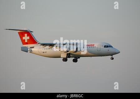 BUDAPEST, HUNGARY - APRIL 7: Swiss airliner approaching Budapest Liszt Ferenc Airport, April 7th 2014. Swiss International - Stock Photo