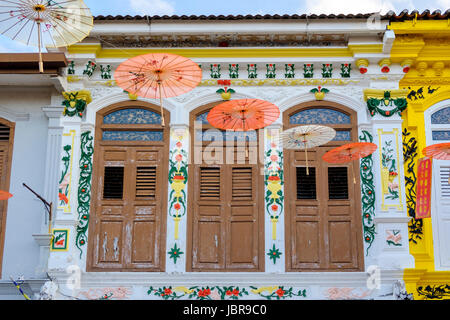 Typical Peranakan-style (Baba-Nyonya, or Straits Chinese) façade mixing Chinese and colonial architectural elements, - Stock Photo