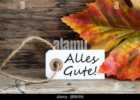The German Words Alles Gute, which means Congratulations, on a Label as Fall Background - Stock Photo