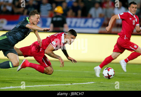 Belgrade. 11th June, 2017. Serbia's Aleksandar Mitrovic (C) vies with Wales's James Chester (L) during group D 2018 - Stock Photo