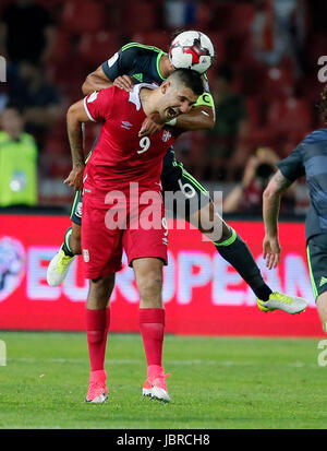 Belgrade. 11th June, 2017. Serbia's Aleksandar Mitrovic (Front) vies with Wales's Ashley Williams during group D - Stock Photo